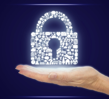 Hand Holding Computer Icons in a Security Padlock Shape